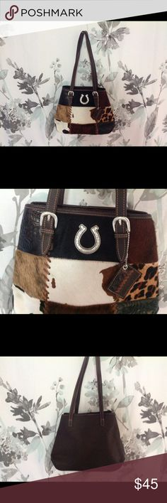 """NWOT American West Handbag / Purse Awesome bag with tooled leather and hair on cowhide on the front.  Has upside down silver horseshoe (to hold the luck!) with 4 silver feet on the bottom.  Lined inside with pockets on one side and zippered pocket on the other side.  Back is a rich, dark brown.  14"""" wide x 10"""" tall x 4"""" deep.  Great condition.  New without tags. American West Bags"""