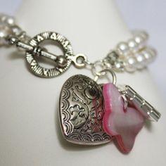 Swarovski crystal pearl bracelet with charms.
