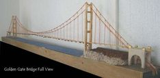 A scale miniature Golden Gate Bridge and how to build one out of improvised materials like match sticks and popsicle sticks. Bridge Model, Arch Model, Popsicle Stick Bridges, Popsicle Sticks, Matchstick Craft, Puente Golden Gate, Bridge Drawing, Suspension Bridge, Old Models