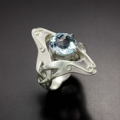 Art Nouveau style ring with a blue topaz. $450.00, via Etsy.