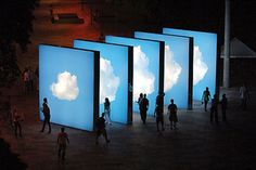 Artist Eduardo Coimbra's cloud art has people floating in his 'mixed-media architectural installations'.