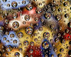 Idea: pour water on saran wrap; it will glob up like this. elevate droplets above a colorful pattern, and something like this could occur