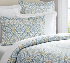 Dawn Print Duvet Cover & Sham; MASTER? This one feels pretty- has blue, white, yellow and soft green...
