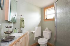 Come on in to take a full tour of this purple tiny house vacation in Portland, Oregon with downstairs bedroom, living area, kitchen, and bathroom. Bathroom Windows, Bathroom Layout, Tiny Living, Living Area, Green Color Schemes, Eco Friendly House, Small Spaces, Sweet Home, Small Homes