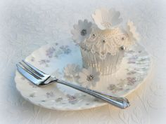 elegant flowers and lace cupcake