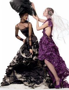 barbiedollfashion:    Coco Rocha (dressed by Alexander McQueen) adjusting the hat of Sasha Pivovarova (dressed by Yves Saint)
