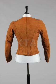 Rare chamois leather lady's riding jacket or under-jacket, 1890s, lined in pale blue silk with brown-stained mother of pearl buttons
