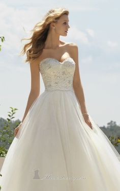 You'll be the most gorgeous bride in Voyage by Mori Lee 6749. This full skirt gown is created from a classic embroidered lace on tulle. The fitted bodice features a strapless and sweetheart neckline. This style is also available in tea length as style 6749. The jacket shown is sold separately.