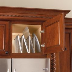 Kitchen cabinet tray dividers.. something so simple would make my baking pans a lot easier to grab and sort