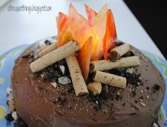 Love it! Pirouette logs, jolly ranchers (do these come in red/orange?) or butterscotch and cinnamon candies melted down to create flames, crumbled Oreos. Battery operated flame in center to make it glow!!