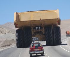 Best way to understand the size of a monster-truck is to see it on a real street along a real car, not in a mine in Australia, the Americas or Africa on a pic all on its own. Dump Trucks, Lifted Trucks, Cool Trucks, Big Trucks, Cool Cars, Mining Equipment, Heavy Equipment, Monster Trucks, You Shall Not Pass