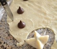 Kiss Pies! So easy. Just pie crust and Hershey kisses, baked up into cute little pies :) What a sweet party idea.