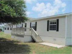 Near Hwy 173 & I-35  Devine, TX 78016  4 Bedroom 2 Bath 2004  2128 SQFT 2.50 Acres