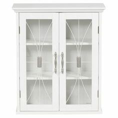 "Pairing style and storage, this sleek wall cabinet features crown molding details with 3 tiers of storage behind 2 glass-paneled doors.  Product: Wall cabinetConstruction Material: Wood and glassColor: WhiteDimensions: 24"" H x 20.5"" W x 8.5"" D"