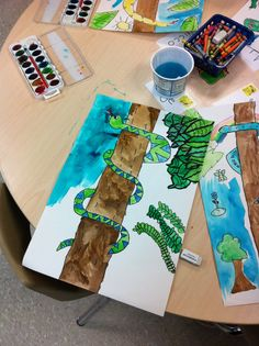 "My grade 1 classes art lesson. Rainforest art lesson inspired by a lesson from ""Deep Space Sparkle"".  I still can't believe how great they turned out!  This is a picture of one in progress."