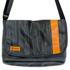 Bicycle inner tube shoulder bag. This one has just the right size to fit an iPad and all the stuff that needs to go in a hand bag. Inner tubes are waterproof and hard- waearing. Over time the rubber gets the patina of leather. Designed and hand made by Q HERE.   www.qhere.net