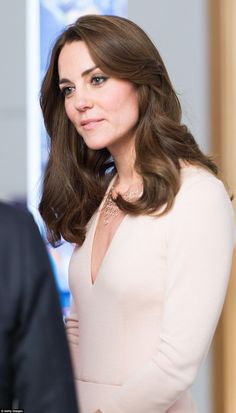 Kate listens intently inside the gallery after looking at her portraits and no doubt is so...