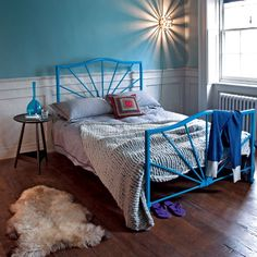 Country bedroom with Victorian bedstead - love the blue