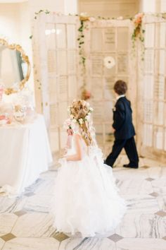 Flower Girl and Ring Bearer Gaze at Vintage Door Seating Chart | Justin  Mary Photography | TheKnot.com