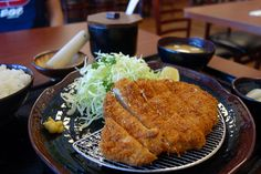 Tonkatsu - Guess iconic photos around the world with a quick swipe! #TravelPop Play Now: http://poplink.me/k8Q4Y8000