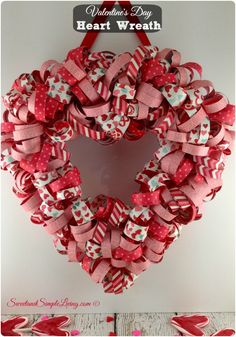 Valentine's Day Heart Wreath Tutorial!!  You've gotta see this one!!! It's made out of strips of PAPER!!!  Too Cute!