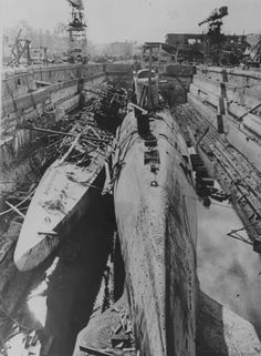 Damaged submarines in drydock in Kiel 1945. It is clear to see the size difference between the Type XXI and the Type IX-B (previously considered a large boat)