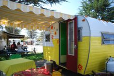cheerful yellow vintage travel trailer