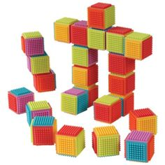These cubes' bristles allow them to interlock and stick together so bitty builders can design playroom masterpieces. CHOKING HAZARD: Small parts. Not for children under 3 years Toddler Toys, Baby Toys, Infant Toddler, Kids Toys, 24 Blocks, Cube Design, Operation Christmas Child, Developmental Toys, Sensory Toys
