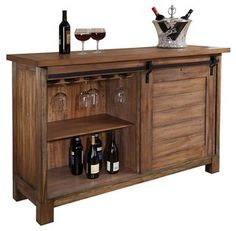 The Howard Miller 695-144 Homestead Wine & Bar Cabinet is part of the Wine & Spirits Collection Home Bar Cabinet Collection. These home bars feature high