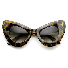 - Description - Measurements - Shipping - Super mod retro womens cat eye sunglasses. Inspired by overdone large and eccentric styles of the 1980's, this style is part of a retro subculture. Era driven