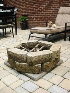 How to build a fire pit for $28. I did mine a little differently. I set the pavers on the sand--3 rows of 8. Then we dug down into the ground a ways. Haven't tried it yet, but it looks nice.