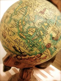 vintage globe to set the travel theme
