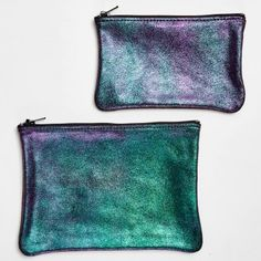 Tracey Tanner Slick Sparkle Pouch    An, iridescent, sparkling metallic finish adds edge to this flat zip-top pouch. Easily transitioning from day to night - it stashes all of the essentials and doubles as a clutch. Handcrafted in Tracey Tanner's Brooklyn studio.