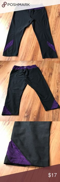 Purple lace & black crop leggings Super cute black crop leggings with purple lace, the lace in the legs is slightly see threw so it barley shows your legs under them. Super comfortable no signs of wear! EUC! Brand is road runner lululemon athletica Pants Ankle & Cropped