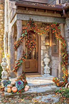 Embellish a store-bought garland by adding bittersweet, fall foliage, or dried hydrangeas. Finish the look with pumpkins and cabbages on the steps and a pine-cone wreath (accented with leaves and flowers on the door.    Tip: Prolong the life of greenery with spritzes of water