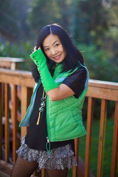 Green puffer vest, green cut off gloves.
