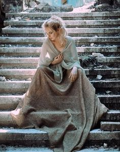 She sat on the ruined steps of her once glorious palace and wept, but she had no tears for the stone. Only for the blood spilled upon the stone.