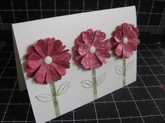 Easy flowers.  Would be cute with the Place & Punch BLOSSOM maker and new gemstones in the center (instead of a brad).