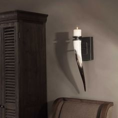 This uttermost romany horn candle sconce is designed by Grace Feyock. It measures wide x high. Accent Wall Decor, Metal Wall Decor, Candle Sconces, Wall Sconces, Mirrors, Silver Highlights, Flickering Lights, Metal Plaque, White Candles