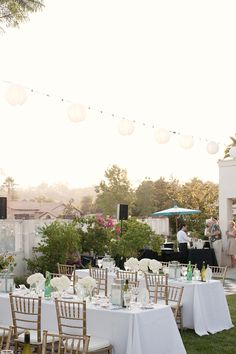 white with gold chiavari chairs. Too white! Make sure flowers have more texture and greens in them.