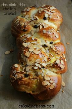 A braided egg based dough made with chocolate chips and topped with almond slivers.