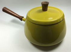Midcentury yellow!  Collect multiple vintage fondue pots and use one for broth…