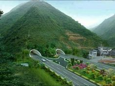 Highway through the mountain in China.  Go to www.YourTravelVideos.com or just click on photo for home videos and much more on sites like this.