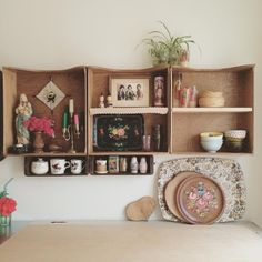 these shelves made from old drawers are doing a peachy job of 'knick knack' holding