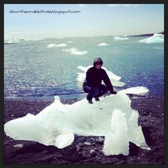 """Climb an iceberg chunk on a North Sea beach at Jokulsarlon, Iceland. Find out more at """"Down the Wrabbit Hole - The Travel Bucket List"""". Click the image for the blog post."""