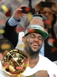 LeBron James enjoys the spoils of victory, his first NBA title in three trips to the Finals. (AFP)