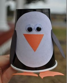 Make a penguin craft out of a paper cup.