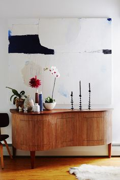 Furniture: Elephant Ceramics porcelain vases, as well as some by Paula Greif and unknown Japanese artisans, are set on a curvaceous Douglas-fir-and-pine console by Moore. A painting by Heather Chontos hangs on the wall..