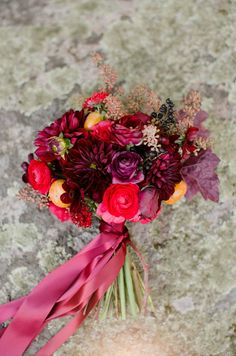 rich dahlia and ranunculus with persimmons, berries and fall leaves by Wild Folk Studio