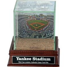 New York Yankees Stadium Background Glass Single Baseball w Yankee Stadium Authentic Dirt & Nameplate - This Steiner Exclusive Glass Display Case is a one of a kind way to commemorate your favorite Yankee signed baseball.Each UV-protected display case is hand-made and includes a removable glass top for easy access. With a mirrored bottom and stunning cherry wood base your memorabilia will look stylish and protected in any setting.This single baseball display case measures in overall size of…
